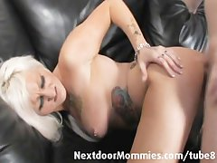 Tattooed MILF takes it not far from the pain in the neck