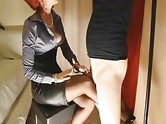 Mature redhead gives her related slut a footjob