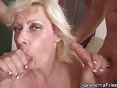 Two guys drill her old holes