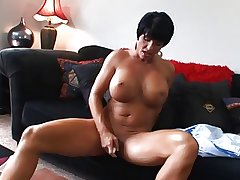 Hot Mature Busty Brunette Cougar Bangs coupled with Wears It