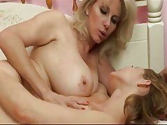 Matured Unshaded Feeds Her Tits down a Teen Girl