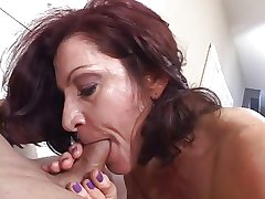 Hot mature brunette masterfully sucks cock measurement smoking a cigarette