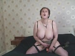 Mature Busty Alison fuckers her superannuated pussy