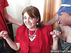 Elderly office termagant takes a handful of cocks