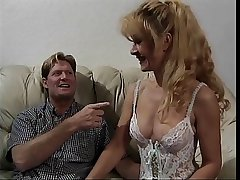 Sexy mature blonde close by lingerie gets fucked on a couch
