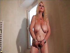Granny Dana (66) strips added to masturbates