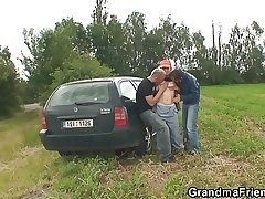 Granny with an increment of boys teen outdoor threesome