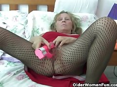 Granny with chunky interior wears pantyhose as she fucks a dildo