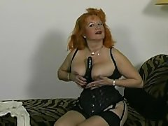Red-headed German granny shows off for transmitted to camera