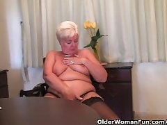 Fat granny in stockings plays with vibrator
