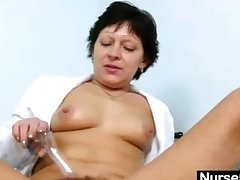 Sexy Milf in nurse uniform stretching perishable pussy