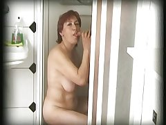 flimsy granny finds a man in her shower